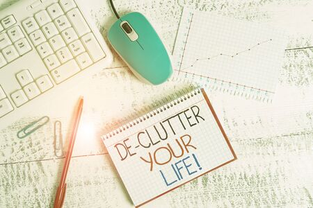 Writing note showing De Clutter Your Life. Business concept for remove unnecessary items from untidy or overcrowded places Wood desk office appliance computer equipaments charts paper slot