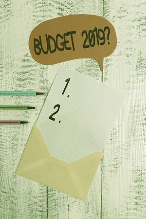 Conceptual hand writing showing Budget 2019 Question. Concept meaning estimate of income and expenditure for next year Envelope speech bubble ballpoints lying wooden retro background Standard-Bild