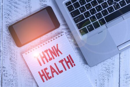 Text sign showing Think Health. Business photo showcasing state of complete physical mental and social well being Metallic laptop blank ruled notepad smartphone lying old wooden table 写真素材