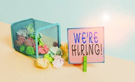 Text sign showing We Re Hiring. Business photo text recently employ someone or pay someone to do particular job Trash bin crumpled paper clothespin empty reminder office supplies tipped