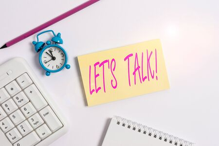 Text sign showing Let S Talk. Business photo text they are suggesting beginning conversation on specific topic White pc keyboard with empty note paper and pencil above white background