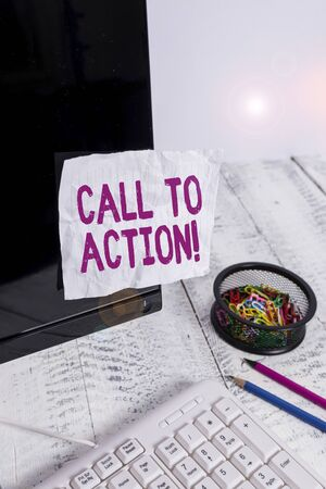 Text sign showing Call To Action. Business photo showcasing exhortation do something in order achieve aim with problem Note paper taped to black computer screen near keyboard and stationary