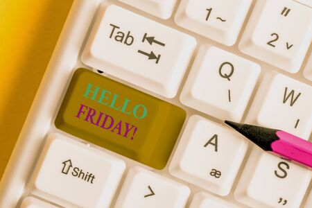 Conceptual hand writing showing Hello Friday. Concept meaning used to express happiness from beginning of fresh week White pc keyboard with note paper above the white background