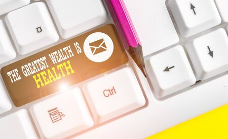 Writing note showing The Greatest Wealth Is Health. Business concept for Many sacrifice their money just to be healthy White pc keyboard with note paper above the white background