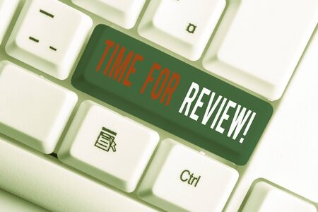Writing note showing Time For Review. Business concept for formal assessment of something with intention instituting change White pc keyboard with note paper above the white background