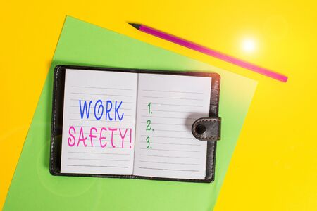 Text sign showing Work Safety. Business photo showcasing policies and procedures in place to ensure health of employees Dark leather private locked diary striped sheets marker colored background