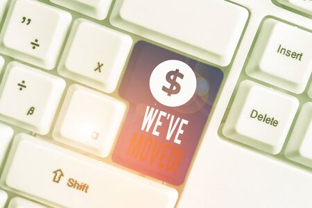 Text sign showing We Ve Moved. Business photo text having strong feelings sadness or sympathy has said or done White pc keyboard with empty note paper above white background key copy space Stock Photo