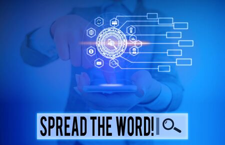 Writing note showing Spread The Word. Business concept for share the information or news using social media Picture photo network scheme with modern smart device