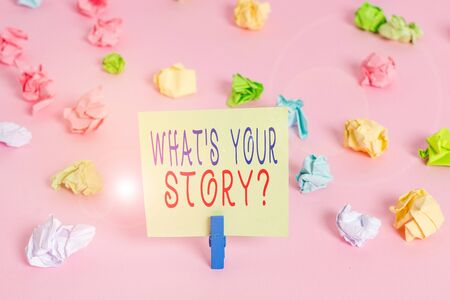 Writing note showing What S Your Story Question. Business concept for asking demonstrating about his past life actions career or events Colored crumpled papers empty reminder pink floor background clothespin
