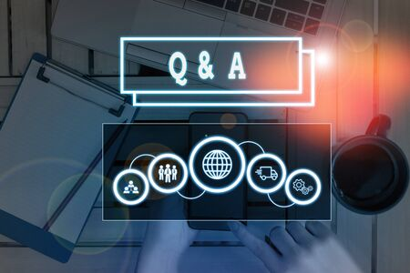 Conceptual hand writing showing Q And A Question. Concept meaning in which demonstrating asks questions and another one answers them Picture photo network scheme with modern smart device
