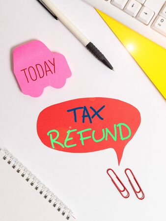 Text sign showing Tax Refund. Business photo showcasing refund on tax when the tax liability is less than the tax paid Red bubble copy space paper on the table with clock