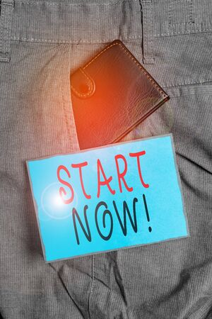 Conceptual hand writing showing Start Now. Concept meaning do not hesitate get working or doing stuff right away Small wallet inside trouser front pocket near notation paper