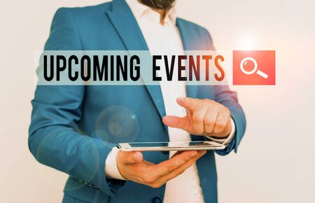 Text sign showing Upcoming Events. Business photo text the approaching planned public or social occasions Businessman with pointing finger in front of him