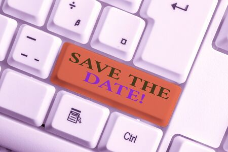 Word writing text Save The Date. Business photo showcasing reserve the mentioned future wedding date on their calendar White pc keyboard with empty note paper above white background key copy space Banco de Imagens