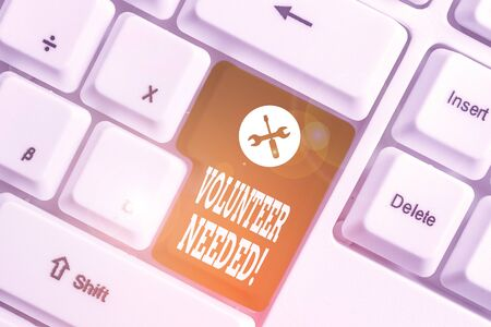 Handwriting text Volunteer Needed. Conceptual photo asking demonstrating to work for organization without being paid White pc keyboard with empty note paper above white background key copy space