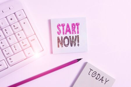 Text sign showing Start Now. Business photo showcasing do not hesitate get working or doing stuff right away White pc keyboard with empty note paper and pencil above white background 版權商用圖片