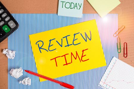 Word writing text Review Time. Business photo showcasing to think or talk about something again Set schedule to review Striped paperboard notebook cardboard office study supplies chart paper Stock fotó