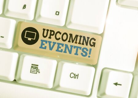 Writing note showing Upcoming Events. Business concept for the approaching planned public or social occasions White pc keyboard with note paper above the white background Фото со стока