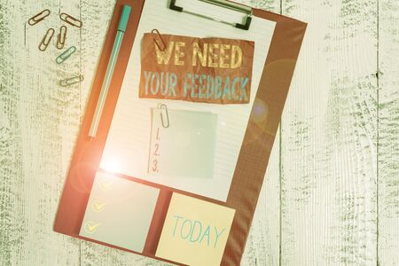 Handwriting text writing We Need Your Feedback. Conceptual photo criticism given to say can be done improvement Clipboard sheet crushed sticky note clip notepads marker wooden background
