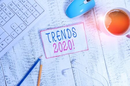 Handwriting text Trends 2020. Conceptual photo general direction in which something is developing or changing technological devices colored reminder paper office supplies keyboard mouse 版權商用圖片