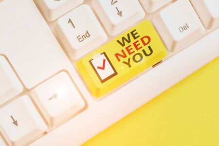 Text sign showing We Need You. Business photo showcasing to fulfill the needs of the assignment duty or obligation White pc keyboard with empty note paper above white background key copy space