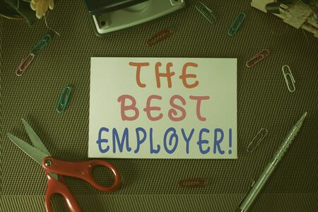 Writing note showing The Best Employer. Business concept for created workplace showing feel heard and empowered Scissor and writing equipments sheet above textured backdrop Banco de Imagens