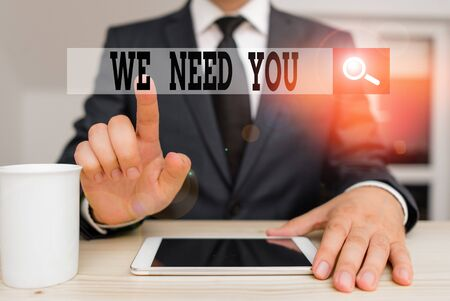 Conceptual hand writing showing We Need You. Concept meaning to fulfill the needs of the assignment duty or obligation Male human wear formal clothes present use hitech smartphone