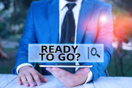 Handwriting text Ready To Go Question. Conceptual photo asking someone if he is prepared or packed his things Businessman with mobile phone in his hand Zdjęcie Seryjne