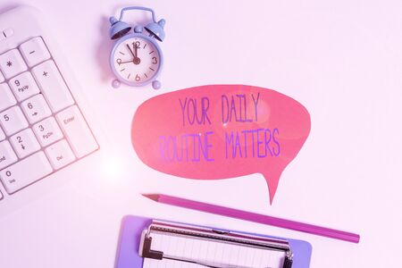 Word writing text Your Daily Routine Matters. Business photo showcasing practice of regularly doing things in fixed order Flat lay above table with clock pc keyboard and copy space note paper