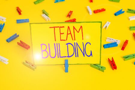 Word writing text Team Building. Business photo showcasing various types of activities used to enhance social relations Colored clothespin papers empty reminder yellow floor background office Zdjęcie Seryjne