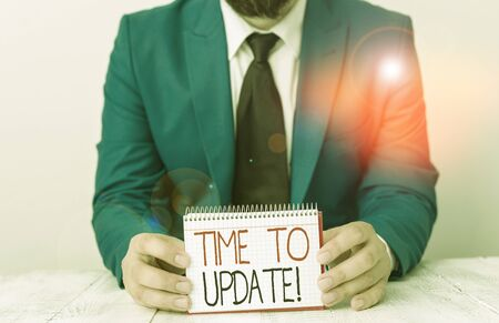 Writing note showing Time To Update. Business concept for this is right moment to make something more modern new Man holds empty paper with copy space in front of him Space Imagens
