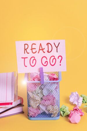 Conceptual hand writing showing Ready To Go Question. Concept meaning asking someone if he is prepared or packed his things Trash bin crumpled paper clothespin office supplies yellow