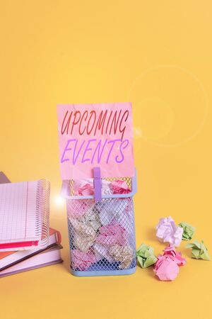 Text sign showing Upcoming Events. Business photo text the approaching planned public or social occasions Trash bin crumpled paper clothespin empty reminder office supplies yellow 版權商用圖片