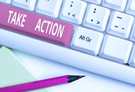 Text sign showing Take Action. Business photo text to do somethingoract in order to get a particular result White pc keyboard with empty note paper above white background key copy space