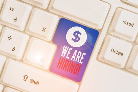 Text sign showing We Are Hiring. Business photo text recently you employ someone or pay someone to do particular job White pc keyboard with empty note paper above white background key copy space