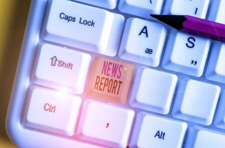 Conceptual hand writing showing News Report. Concept meaning spoken or written account of something that one has observed White pc keyboard with note paper above the white background