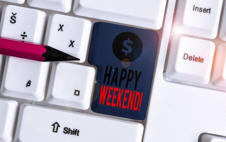 Conceptual hand writing showing Happy Weekend. Concept meaning something nice has happened or they feel satisfied with life White pc keyboard with note paper above the white background Фото со стока