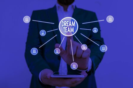 Text sign showing Dream Team. Business photo showcasing Prefered unit or group that make the best out of a demonstrating Male human wear formal work suit presenting presentation using smart device
