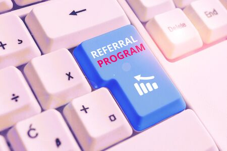 Conceptual hand writing showing Referral Program. Concept meaning employees are rewarded for introducing suitable recruits White pc keyboard with note paper above the white background