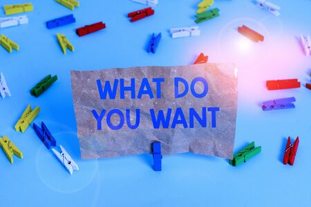 Text sign showing What Do You Want. Business photo text used for offering something to someone or asking their need Colored clothespin papers empty reminder blue floor background office pin