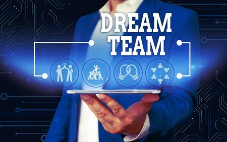 Conceptual hand writing showing Dream Team. Concept meaning Prefered unit or group that make the best out of a demonstrating Male wear formal work suit presenting presentation smart device