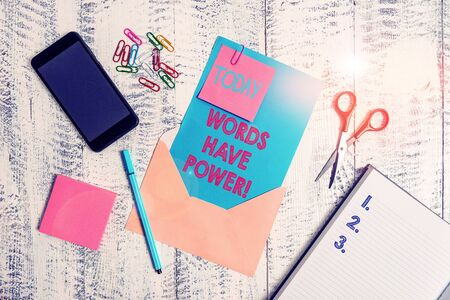 Writing note showing Words Have Power. Business concept for as they has ability to help heal hurt or harm someone Envelope sheet smartphone notes pen notepad clips scissors wooden back