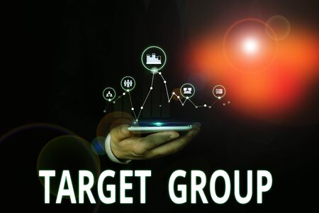 Text sign showing Target Group. Business photo showcasing Particular showing that an advertisement intended to reach to Male human wear formal work suit presenting presentation using smart device