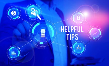Word writing text Helpful Tips. Business photo showcasing Ask an Expert Solutions Hints Consulting Warning Male human wear formal work suit presenting presentation using smart device Imagens