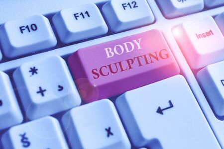 Text sign showing Body Sculpting. Business photo text activity of increasing the body s is visible muscle tone White pc keyboard with empty note paper above white background key copy space