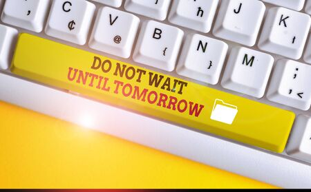 Text sign showing Do Not Wait Until Tomorrow. Business photo text needed to do it right away Urgent Better do now White pc keyboard with empty note paper above white background key copy space