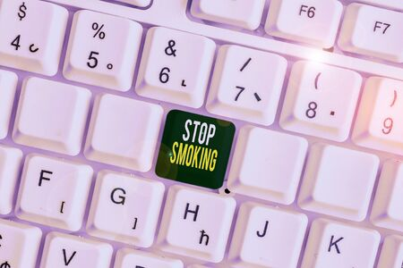 Handwriting text Stop Smoking. Conceptual photo Discontinuing or stopping the use of tobacco addiction White pc keyboard with empty note paper above white background key copy space