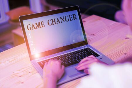 Word writing text Game Changer. Business photo showcasing Sports Data Scorekeeper Gamestreams Live Scores Team Admins woman laptop computer smartphone mug office supplies technological devices