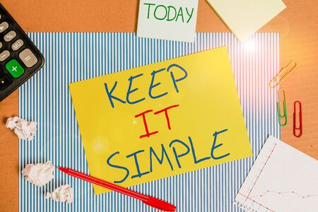 Word writing text Keep It Simple. Business photo showcasing to make something easy to understand and not in fancy way Striped paperboard notebook cardboard office study supplies chart paper
