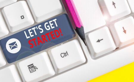 Writing note showing Let S Get Started. Business concept for encouraging someone to begin doing something White pc keyboard with note paper above the white background